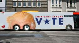 """An undated photo provided by SF of a bus whose sides depict U.S. presidential candidate Donald Trump's forehead with eyes painted on the turning wheels. The bus started traveling on a major route in Copenhagen Wednesday Oct. 26, 2016. Pia Olsen Dyhr, chairwoman of the small Socialist People's Party, told The Associated Press it was """"pretty clear"""" which candidate the party prefers, but added: """"I don't think Trump as president will be positive for the development of the world and therefore Denmark."""" (SF/Polfoto via AP)"""